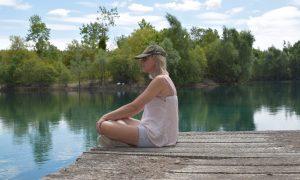 Ladie on the jetty of carpfishing lake la saule paquot